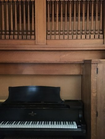 Grand piano tucked under the staircase
