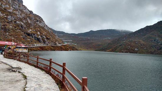It was October 10, 2018 when we visited East Sikkim. We took shared cab in the morning. Prior to this, we had to contact the driver who took ID proof and two copy passport size photographs to make necessary arrangements for the pass. Talking about this beautiful picture, we were so amazed to see the calmness of the water of the lake.