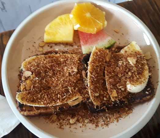 Thongs French Toast with toasted coconut, almonds, and bananas