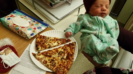 Walkerton, Canada: Our 1 day old introduced to Old Garage Pizza