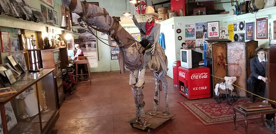 Paul Bunyon Statue: Statue of a man and horse made from junk.