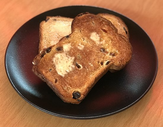 Raisin Toast - 2 thick slices of our home-made raisin bread toped with dripping butter.