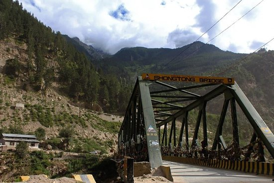 Shongtong Bridge - The Metal Bridge  This beautiful bridge is on the way to reckong peo kinnaur.Bridge is surrounded by beautiful mountain.This solid metal bridge is adorned with Buddhist prayer flags which make it all the more beautiful.