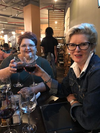 Kraaifontein, South Africa: Clinking a glass of very good red with long lost family