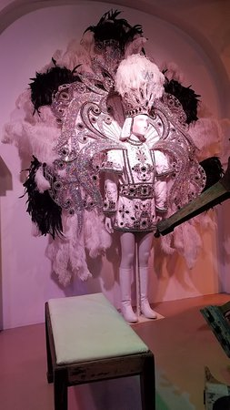 Elaborate Mardi Gras costume at entrance to the museum