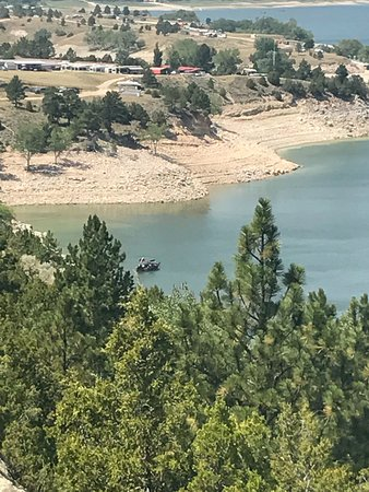 Glendo, WY: Hubbie's boat from a hiking trail.