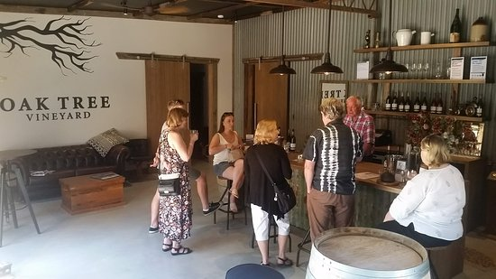 Oak Tree Vineyard: The new Oak Tree Cellar door, with host and winemaker Brian behind the counter.