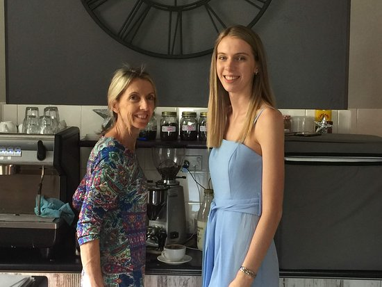 The owner of Mosaique with one of her daughters