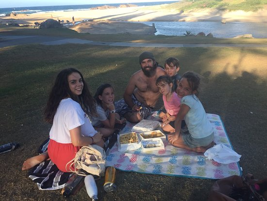 Big family feed of fish and chips by the beach