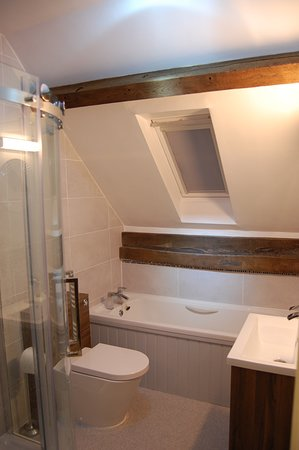 Symonds cottage bathroom with bath and power shower