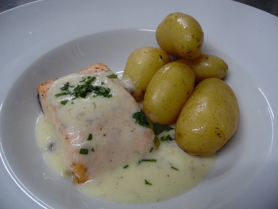 Huercal-Overa, Spain: Pan Fried Fillet of Salmon with a Lemon Caper Butter Sauce and New Potatoes.