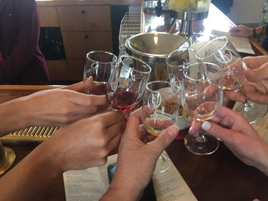 Michigan Yoga & Wine Weekend: Our first tasting of the day! After visiting Torch Lake Cellars, we head over to Old Mission Peninsula for more wine tastings and lunch on the beach at Mission Point Lighthouse.