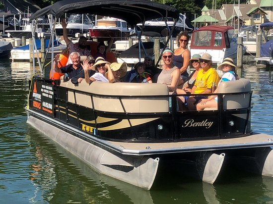 Macatawa, MI: A big family having a great time on our 24' tritoon. It holds up to 16 people!