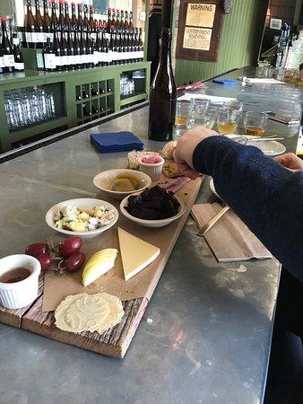 Enjoying a sampler board at Wayside Cider!