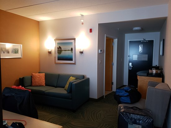 Seating area in the room; bathroom is to the left.