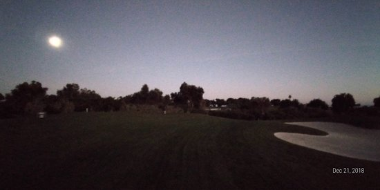 With the moon on one side while putting of the green