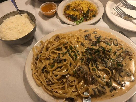 Pearland, تكساس: Main course: Veal Marsala, with generous bowl of feathery Parmesan cheese.  Veal was tender, sauce and pasta were excellent.  Very satisfying! 