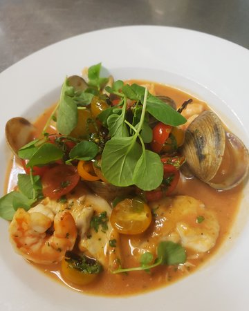 Bouillabaisse with vine-ripened cherry tomato salad