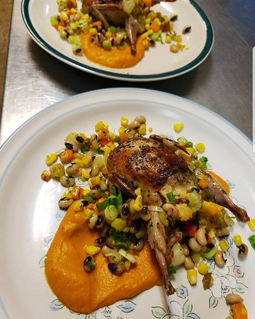 Quail atop pureed sweet potato with a black-eyed pea and corn succotash
