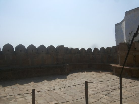 The whole complex appears to be in a fortified walls which are slowly eaten away by modern buildings coming up.