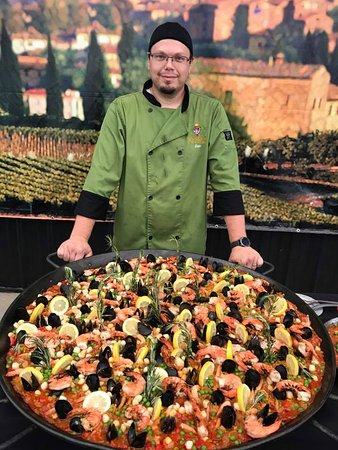 Wine maker and chef Ben Banks serving spanish Paella
