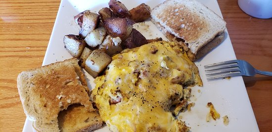 Ham omelet with home fries and rye toast.