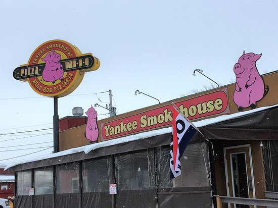 Ossipee, NH: You cannot miss the pink pigs of the Yankee Smokehouse, nor the distinctive smoked meat scent in the air.