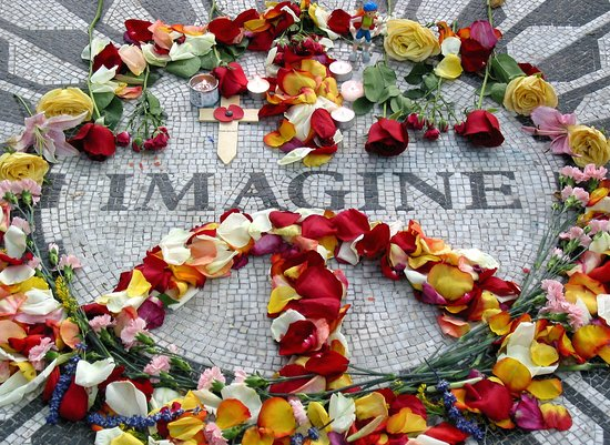 """The """"Imagine"""" mosaic at Strawberry Fields in Central Park, NYC decorated with flowers for the 9-11 anniversary. The gallery has available prints in various sizes, framed and/or matted."""