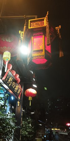 Guangzhou Lychee Bay Old Street night scene. With Chinese New Year holidays approaching, this famous old street of rich Guangzhou local cultural elements is decorated with traditional lanterns and couplets, making it charming at night.