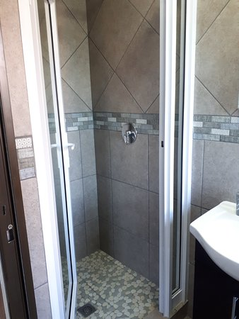 Blue Sea Unit 2 - modern tiled delight - en-suite bathroom with a shower, toilet and hand-basin. Soap and towels provided, but bring own swimming and beach towels please.