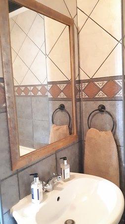 Blue Sea Unit 4 - Ultra modern full bathroom, corner bath, big shower, toilet and hand basin. Soap and towels provided bring own beach towels please.