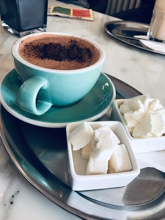 Waffel oder Becher: Amazing Hot White Chocolate! Super friendly staff. They make their own marshmallows and they were perfect. I would go back to try a waffle. If you're looking for a quiet spot to decompress with a cup of coffee and you're in the area check it out.