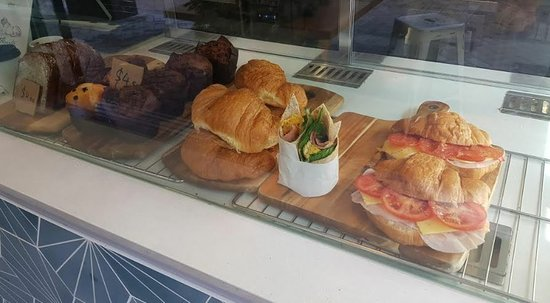 Ham cheese tomato croissants as well as a variety of wraps, pastries and muffins