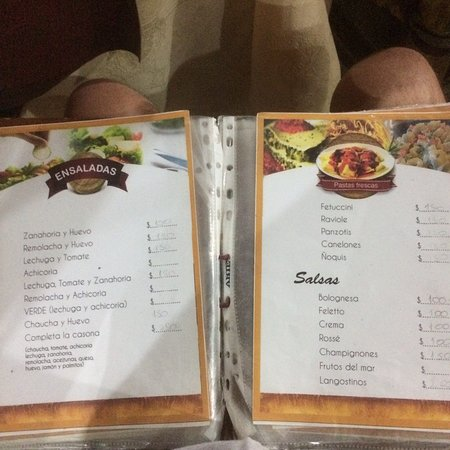 Pics of menu from this out of centre (not far though) family run restaurant with no tourists. Locals enjoying affordable Parillas. Children serving and clearing. No English. Friendly but bored service. Mistakes made re food & wine so be very insisting and watch bill at end as wine availability on menu not matching (or prices on bill). Cheap service charge (20) but expensive sides, although generous. Food good overall but a bit of an adventure! Probably best to get mum to serve. Fox boxing on TV