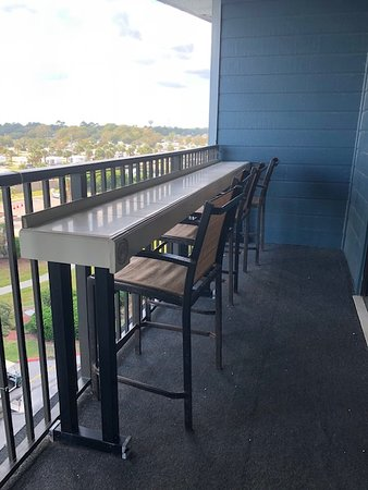 Custom bar on balcony for extra seating, enjoying a drink while watching the waves or listening to the music from the cabana bar.