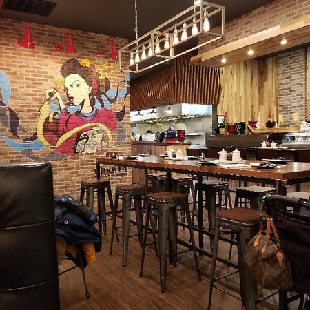 Hakata Ramen and sushi modern decor but off trend additions like fake flowers