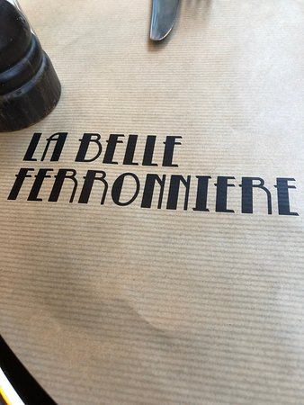 Love the fonts for on the table cover  - Picture of La Belle