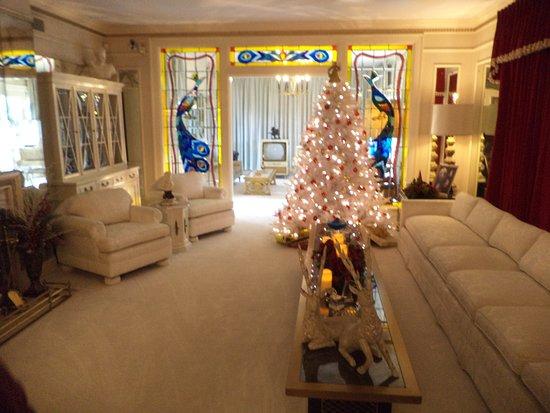 Graceland living room decorated for Christmas Season.