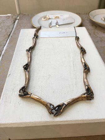 Gorgeous Bronze Connecting Hands Necklace by Alice Scott of Symbology Jewelry, here at CURVE Studios!