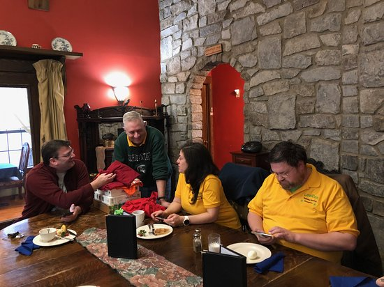 Eating in the dining room at Ravenwood Castle for Boardgame meeting for CinCityCon Boardgaming Convention.