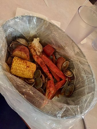 Clams, crab legs, potatoes, sausage and corn with mild-level spice.  Delicious!