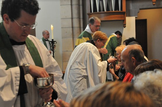 Members of congregation receiving Eucharist at high altar