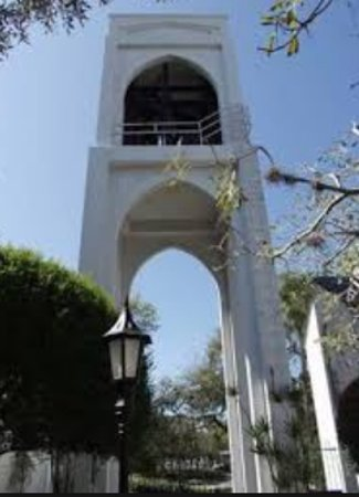 Bell tower to right of church