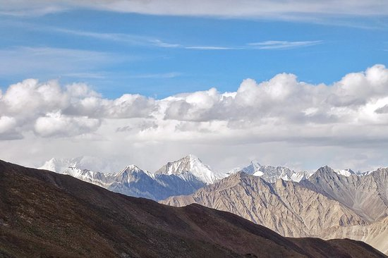The Ssser Muztagh of the Karakoram Range as seen from Khardung La, one of the highest Motorable Passes in the World.    Read more at : https://travelthehimalayas.com/kiki/the-muztagh