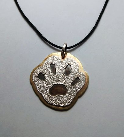 Paw print pendant in brass and silver with sandpaper detail