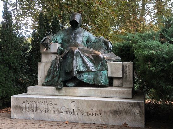 Statue of Anonymous next to the Vajdahunyad Castle