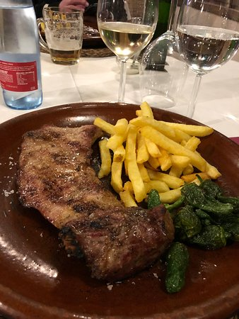 Los Romanes, Spain: The delicious Secreto Iberico pork steak with chilies and chips.