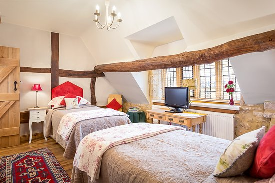 End to End Twin Beds. Room and en-suite features low beams