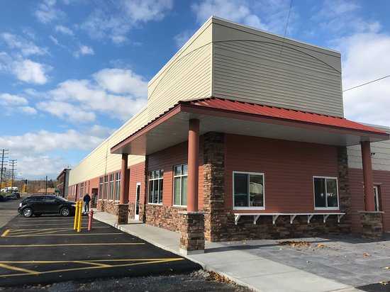 Newark, NY: The south side of the building overlooking the historic Erie Canal and featuring entrances to our cafe, ice cream shop, and public restrooms.