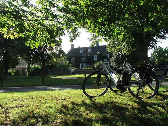 The village green in Kingham - home of Cotswld Electric Bike Tours.